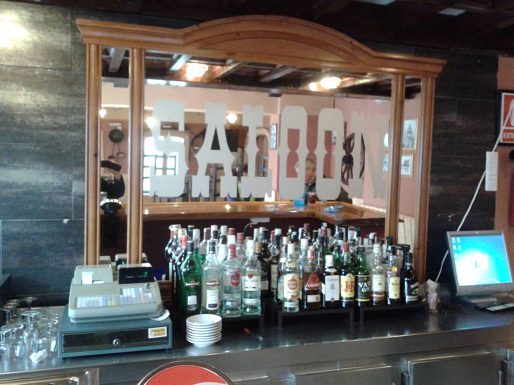 The Beer On Tap Is Budweiser As One Might Expect And There Traditional Large Mirror Behind Bar