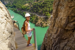 Woman hiking in mountainous area, in the Caminito del Rey, Malaga, Spain.